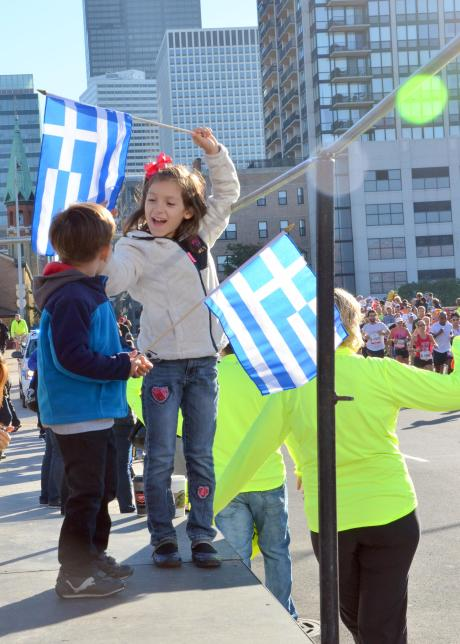 Kids cheering together in Greektown
