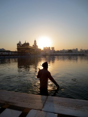 Sevadar (Volunteers) cleaning the water around Golden temple