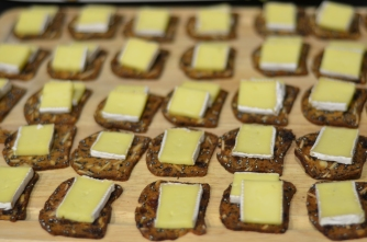 Crackers with brie cheese to be dressed in class