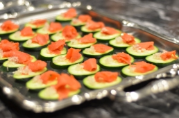 Wild Smoked Salmon and shallots on top of cucumbers